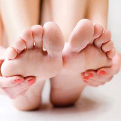 Hands holding feet